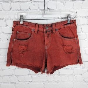 Free People mid rise red denim shorts 26